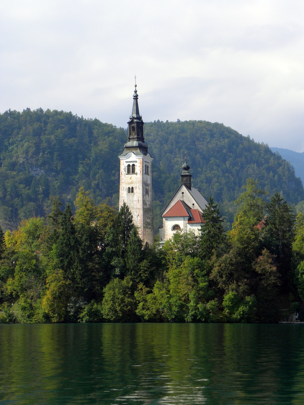 The picturesque Church of the Assumption sits in the middle of an alpine lake in the fairytale town of Bled, Slovenia