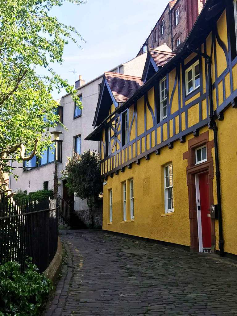 old yellow row homes in dean village edinburgh